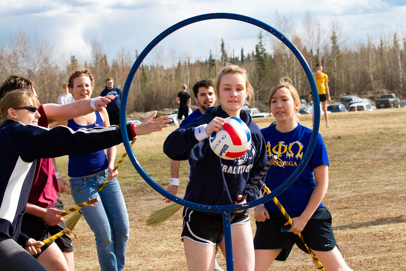"""Students riding on """"enchanted"""" brooms play quidditch during the 2012 Spring Fest field day activities.  <div class=""""ss-paypal-button"""">Filename: LIF-12-3384-209.jpg</div><div class=""""ss-paypal-button-end"""" style=""""""""></div>"""