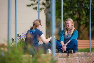 Students enjoy the nice weather on campus during the first day of classes for the fall semester.  Filename: LIF-12-3529-017.jpg