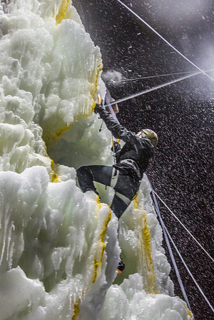 A competitor makes his way to the top of the ice wall during a climbing contest on March 1.  Filename: LIF-13-3748-167.jpg