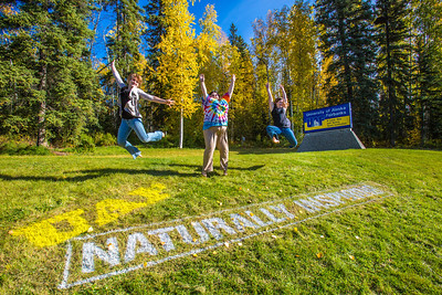 Kaylie Wiltersen, left, Grace Amundsen, center, and Lily Grbavach are so inspired they leap for joy   near the west entrance to campus on a nice fall afternoon.  Filename: LIF-12-3544-047.jpg
