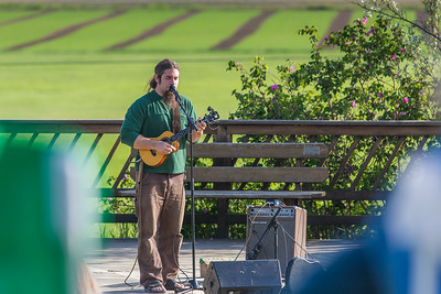 Local musician Ukulele Russ entertained a nice crowd during UAF Summer Session's free Music in the Garden concert series June 12.  Filename: LIF-14-4209-15.jpg