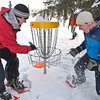 "Blaine DeWalt (left) and Sam Braband (right) play a game of  Frisbee golf in snowshoes as part of UAF's Winter Carnival.  <div class=""ss-paypal-button"">Filename: LIF-12-3303-05.jpg</div><div class=""ss-paypal-button-end"" style=""""></div>"