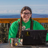 """Carolyn Lang works on her bachelor's degree in Justice from a deck about 30 miles north of Fairbanks. The deck overlooks the dog yard where she works as a handler for Iditarod musher Ken Anderson. Lang completed her degree in three years, mostly through distance-delivered courses which saved her the long commute to campus.  <div class=""""ss-paypal-button"""">Filename: LIF-15-4530-092.jpg</div><div class=""""ss-paypal-button-end""""></div>"""