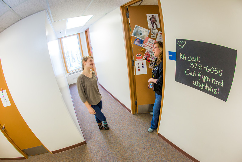 """Music major Kaylie Wiltersen, left, visits with resident advisor Mary Clare Cabel in Skarland Hall.  <div class=""""ss-paypal-button"""">Filename: LIF-13-3735-87.jpg</div><div class=""""ss-paypal-button-end"""" style=""""""""></div>"""
