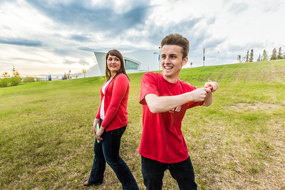 Friends Aaron Druyvestein and Serena McCormick enjoy a round of disc golf on the campus course near the University of Alaska Museum of the North.  Filename: LIF-14-4191-124.jpg