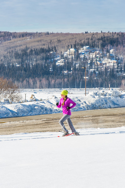 "One of the leaders in the second annual Troth Yeddha' Park Snowshoe Scramble makes her down Yukon Drive Saturday, March 1 to help raise awareness for the proposed park to help celebrate Alaska's Native culture.  <div class=""ss-paypal-button"">Filename: LIF-14-4079-36.jpg</div><div class=""ss-paypal-button-end"" style=""""></div>"