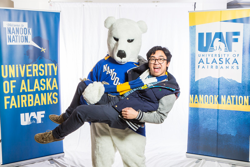"""UAF student ambassadors pose for photos during the photobooth at Inside Out.  <div class=""""ss-paypal-button"""">Filename: LIF-16-4839-98.jpg</div><div class=""""ss-paypal-button-end""""></div>"""