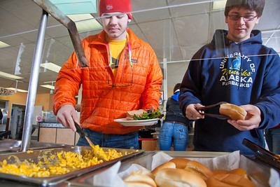 Students load up their plates during their lunch break in the Lola Tilly Commons.  Filename: LIF-11-3220-070.jpg