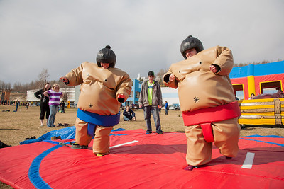 Ashley Bartolowits (left) and her sister Jennifer (right) compete in sumo suits at the Spring Fest Field Day.  Filename: LIF-12-3381-4.jpg
