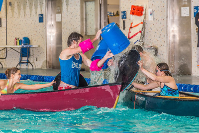 Battleship is a popular intramural sport at UAF. Teams in canoes try to swamp each other's boats during a tournament in the Patty pool.  Filename: LIF-13-3975-52.jpg