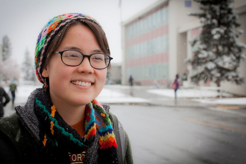 """UAF student Clarissa Zeller waits at the bus stop on the first snowy day on campus.  <div class=""""ss-paypal-button"""">Filename: LIF-11-3199-52.jpg</div><div class=""""ss-paypal-button-end"""" style=""""""""></div>"""