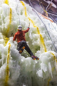 A competitor makes his way to the top of the ice wall during a climbing contest on March 1.  Filename: LIF-13-3748-199.jpg