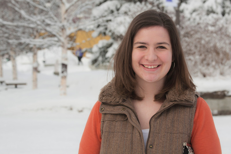 """Graduation Coordinator, Faith Fleagle poses for a photo while crossing campus.  <div class=""""ss-paypal-button"""">Filename: LIF-12-3319-05.jpg</div><div class=""""ss-paypal-button-end"""" style=""""""""></div>"""