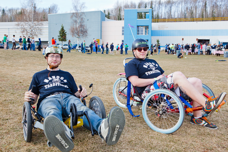 """Electrical Engineering major Isaac Thompson (left) and Mechanical Engineering major Karlin Swearingen pose for a portrait with their electronic powered tricycles during the 2012 Spring Fest field day activities.  <div class=""""ss-paypal-button"""">Filename: LIF-12-3384-74.jpg</div><div class=""""ss-paypal-button-end"""" style=""""""""></div>"""