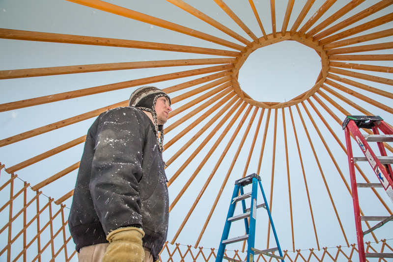 """Erik Ofelt, assistant director with UAF's Department of Recreation, Adventure and Wellness, watches progress being made on construction of a yurt at the top of the new terrain park.  <div class=""""ss-paypal-button"""">Filename: LIF-13-3691-6.jpg</div><div class=""""ss-paypal-button-end"""" style=""""""""></div>"""