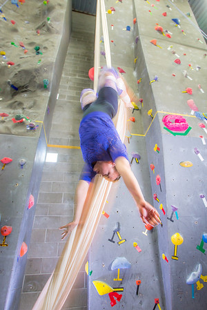 Graduate student Stephany Jeffers practices her silk climbing skills in the SRC.  Filename: LIF-13-3819-179.jpg