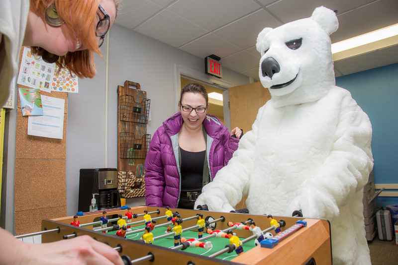 """The UAF mascot enjoys a game of foosball with colleagues in an Eielson Building office.  <div class=""""ss-paypal-button"""">Filename: LIF-14-4101-9.jpg</div><div class=""""ss-paypal-button-end"""" style=""""""""></div>"""
