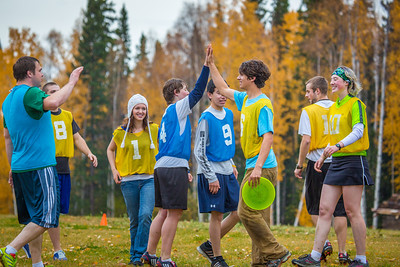 Adam McCombs, #6, celebrates a score with teammates and opponents during an ultimate frisbee scrimmage on campus.  Filename: LIF-12-3557-165.jpg