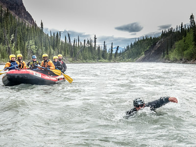 UAF Outdoor Adventures recreation manager Sam Braband swims between rafts during a float trip down the Nenana River in June, 2014.  Filename: OUT-14-4211-118.jpg