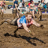 "Cyrus Bee gets down and dirty in the mud volleyball games of Spring Fest on the Fairbanks campus.  <div class=""ss-paypal-button"">Filename: LIF-12-3376-106.jpg</div><div class=""ss-paypal-button-end"" style=""""></div>"
