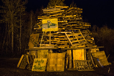 One of the student-built structures stands ready to burn moments before being lit for the annual Starvation Gulch bonfire tradition on the Fairbanks campus on Sept. 2014.  Filename: LIF-14-4333-9.jpg