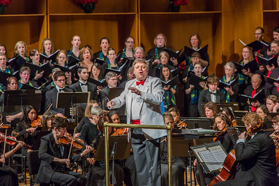 Conductor Eduard Zilberkant turns around to lead the audience in song during the Fairbanks Symphony's annual holiday concert in the Davis Concert Hall.  Filename: LIF-13-4016-121.jpg
