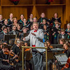 """Conductor Eduard Zilberkant turns around to lead the audience in song during the Fairbanks Symphony's annual holiday concert in the Davis Concert Hall.  <div class=""""ss-paypal-button"""">Filename: LIF-13-4016-121.jpg</div><div class=""""ss-paypal-button-end"""" style=""""""""></div>"""
