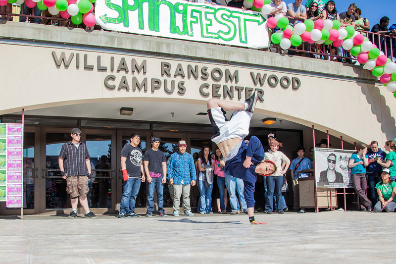 "Dancers help kick off the annual SpringFest celebration in front of the Wood Center.  <div class=""ss-paypal-button"">Filename: LIF-12-3373-135.jpg</div><div class=""ss-paypal-button-end"" style=""""></div>"