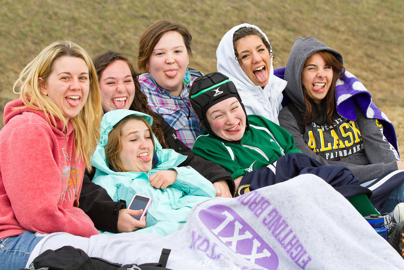 """Students watch the UAF rugby club play an exhibition game as part of the Spring Fest activities on the Fairbanks campus.  <div class=""""ss-paypal-button"""">Filename: LIF-12-3384-138.jpg</div><div class=""""ss-paypal-button-end"""" style=""""""""></div>"""