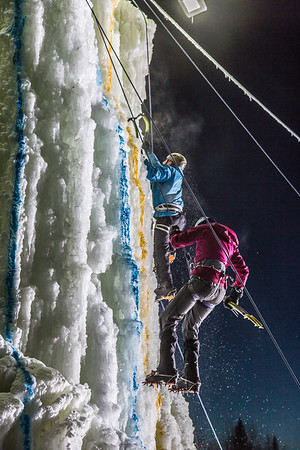 Climbers ascend and descend from the top of the tower during the ice climbing competition, offered as part of the 2014 UAF Winter Carnival.  Filename: LIF-14-4084-82.jpg