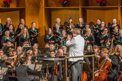 Conductor Eduard Zilberkant applauds members of the Fairbanks Symphony Orchestra along with the Fairbanks Symphony Chorus after a selction from the annual holiday concert in the Davis Concert Hall.  Filename: LIF-13-4016-57.jpg