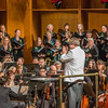 "Conductor Eduard Zilberkant applauds members of the Fairbanks Symphony Orchestra along with the Fairbanks Symphony Chorus after a selction from the annual holiday concert in the Davis Concert Hall.  <div class=""ss-paypal-button"">Filename: LIF-13-4016-57.jpg</div><div class=""ss-paypal-button-end""></div>"