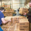 "SFOS IT manager John Haverlack, left, and Institute of Northern Engineering Director Dan White load boxes onto pallets for delivery around Fairbanks while volunteering at the Fairbanks Community Food Bank.  <div class=""ss-paypal-button"">Filename: LIF-12-3661-25.jpg</div><div class=""ss-paypal-button-end"" style=""""></div>"