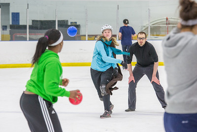 Undergraduates Vicki Milton and Lindsey Klueber were among a big crowd who turned out for a fun game of ice dodgeball on the Patty Ice during UAF's 2014 Winter Carnival.  Filename: LIF-14-4087-77.jpg