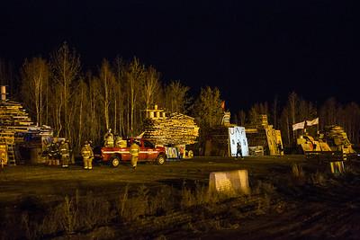 University Firefighters prepare the bonfires at the Nenana Parking lot.  Filename: LIF-14-4333-20.jpg