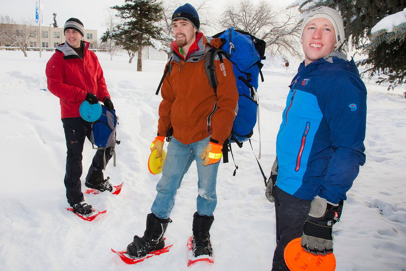 """Blaine DeWalt (left), Mark Oldmixon and Sam Braband (right) play a game of  Frisbee golf in snowshoes as part of UAF's Winter Carnival.  <div class=""""ss-paypal-button"""">Filename: LIF-12-3303-06.jpg</div><div class=""""ss-paypal-button-end"""" style=""""""""></div>"""