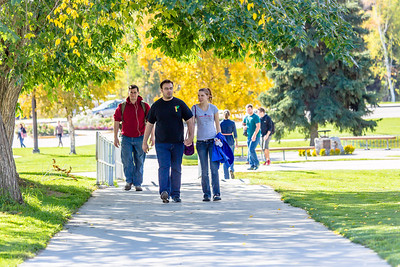 Jacob Monagle and Lindy Olmstead walk up the hill after lunch in the Commons on a beautiful September afternoon on the Fairbanks campus. Monagle is a senior majoring in electrical engineering. Olmstead is studying to become a nurse.  Filename: LIF-13-3934-116.jpg