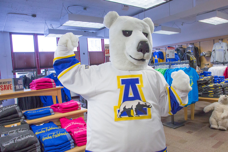 """The UAF mascot tries on a new jersey in the UAF Bookstore in Constitution Hall.  <div class=""""ss-paypal-button"""">Filename: LIF-14-4101-41.jpg</div><div class=""""ss-paypal-button-end"""" style=""""""""></div>"""