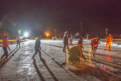 Outdoor broomball, played on the ice in front of the SRC, is a popular intramural sport at UAF.  Filename: LIF-12-3652-149.jpg