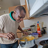 "Peter Ikewun, a petroleum engineeering graduate student from Nigeria, prepares a traditional African soup in his communal Wickersham Hall kitchen.  <div class=""ss-paypal-button"">Filename: LIF-12-3268-196.jpg</div><div class=""ss-paypal-button-end"" style=""""></div>"