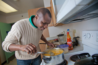 Peter Ikewun, a petroleum engineeering graduate student from Nigeria, prepares a traditional African soup in his communal Wickersham Hall kitchen.  Filename: LIF-12-3268-196.jpg