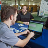 "Assistant coordinator Josh Hovis completes an online survey conducted by UAF's Office of Sustainability to gain insight into the proposed sustainable village concept. Working the survey table are Office of Sustainability board members Wyatt Hurlbut, left, and Brett Parks.  <div class=""ss-paypal-button"">Filename: LIF-11-3214-27.jpg</div><div class=""ss-paypal-button-end"" style=""""></div>"