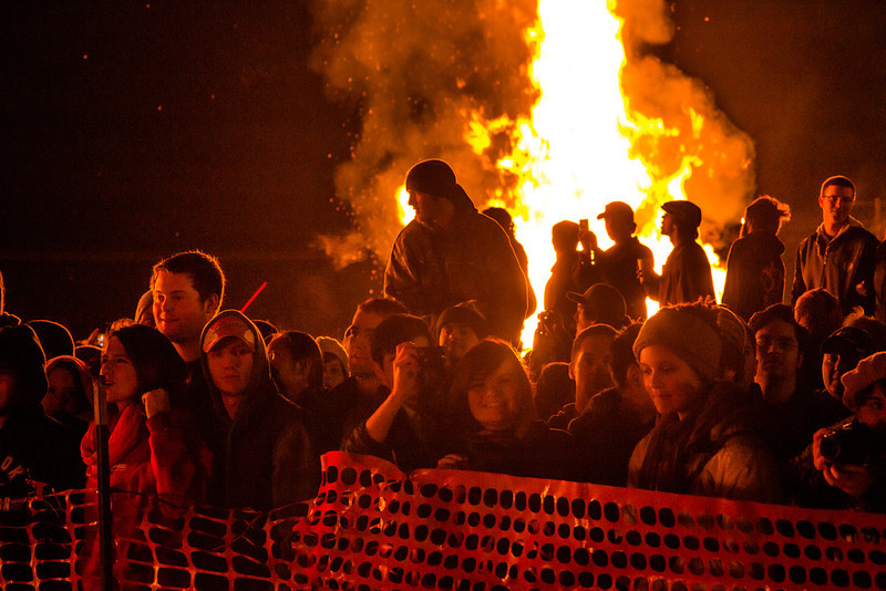 """Students and community members join in the fun and feel the heat during the 2012 Starvation Gulch bonfires celebration.  <div class=""""ss-paypal-button"""">Filename: LIF-12-3571-142.jpg</div><div class=""""ss-paypal-button-end"""" style=""""""""></div>"""