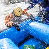 "Expedition leader Bryson DeRondeclimbs back aboard after taking a dip during a day-long raft trip down a beautiful stretch of the Nenana River offered by UAF Outdoor Adventures.  <div class=""ss-paypal-button"">Filename: OUT-12-3492-150.jpg</div><div class=""ss-paypal-button-end"" style=""""></div>"
