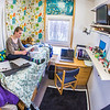 "Music major Kaylie Wiltersen studies in her Skarland Hall single room.  <div class=""ss-paypal-button"">Filename: LIF-13-3735-26.jpg</div><div class=""ss-paypal-button-end"" style=""""></div>"