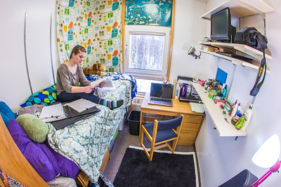 Music major Kaylie Wiltersen studies in her Skarland Hall single room.  Filename: LIF-13-3735-26.jpg