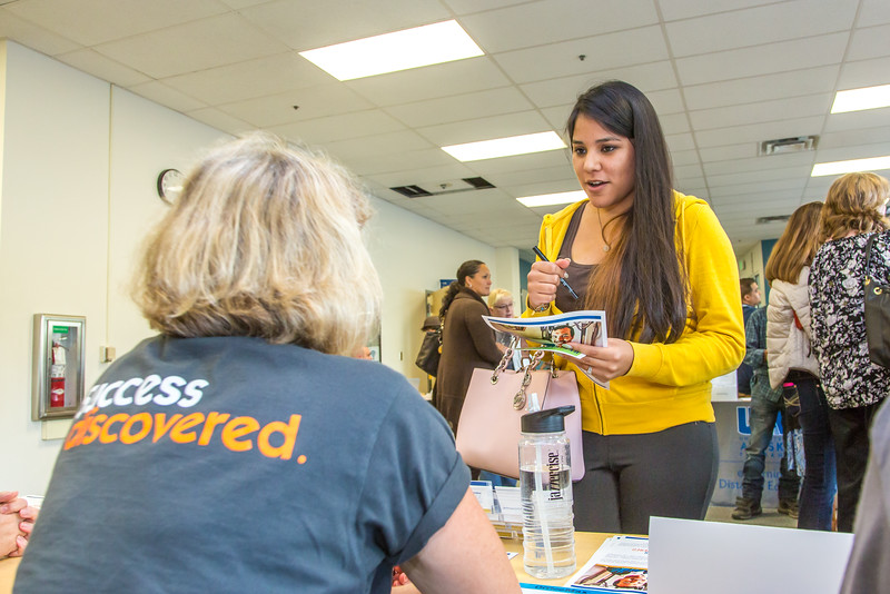 """Staff members turn out to answer community members' questions during the UAF Community and Technical College's (CTC) fall semester round up.  <div class=""""ss-paypal-button"""">Filename: LIF-15-4619-24.jpg</div><div class=""""ss-paypal-button-end""""></div>"""
