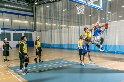 Intramural basketball action on a Tuesday night at the Student Recreation Center.  Filename: LIF-14-4111-287.jpg