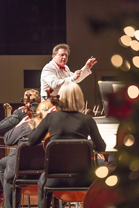 Conductor Eduard Zilberkant leads the Fairbanks Symphony Orchestra in their annual holiday performance in the Davis Concert Hall.  Filename: LIF-12-3669-28.jpg
