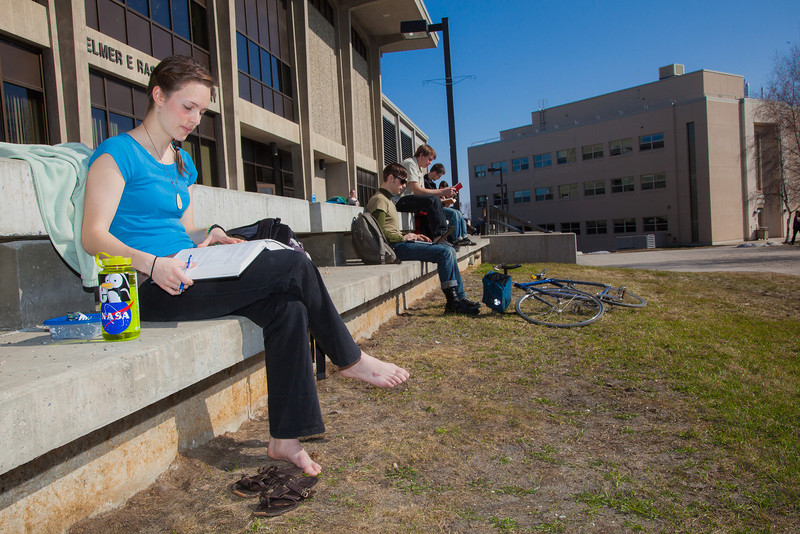 "Rebekah Tsigonis goes barefoot while enjoying some nice weather outside on campus after a long winter.  <div class=""ss-paypal-button"">Filename: LIF-12-3356-51.jpg</div><div class=""ss-paypal-button-end"" style=""""></div>"